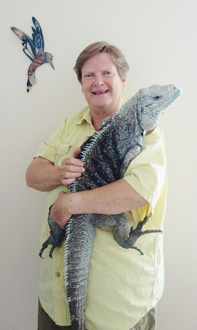 photograph of Elaine A Powers with her large rock iguana, Blue