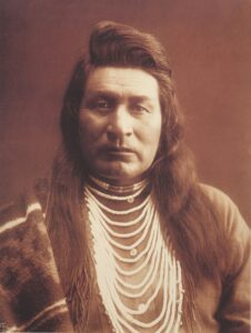 photo of native American man, possibly taken in 1899