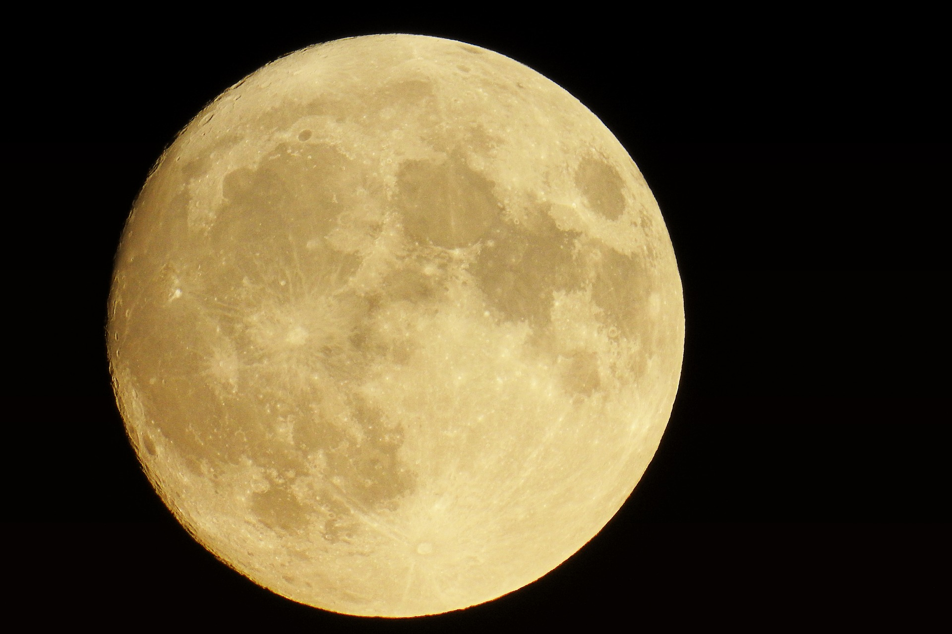 image of a light gold full moon