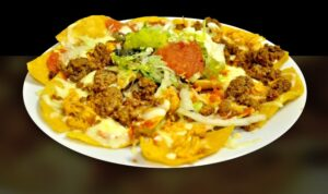 photo of nachos with beef and veggies