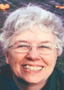 head shot of Nora Miller, editor
