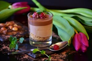 photo of a glass of chocolate mousse on a table