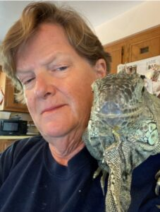 photo of elaine a powers with iguana