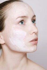 image of young woman's face with lotion