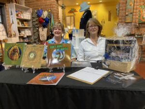photo of author Elaine A. Powers at book signing